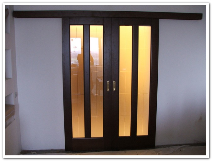 Двустворчатые раздвижные двери своими руками